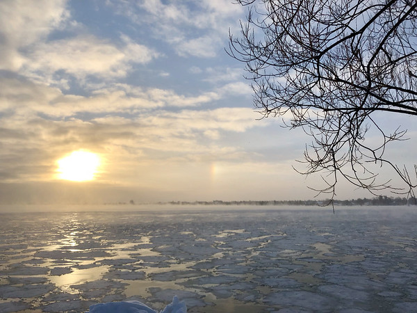 January morning sun over West Bay and the Traverse City skyline.  Photo by Jon Constant.