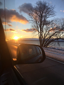 Sunset over East Bay from the passenger seat. Photo by Natalie Dykstra.