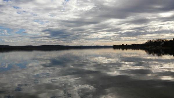 Reflective skies on Lake Leelanau. Photo by Charlie Inman.