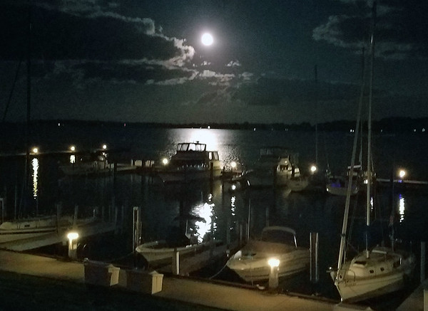 A moon over Suttons Bay. Photo by RJ Loehr.