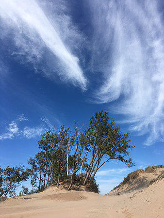 Whimsical clouds over Sleeping Bear Dunes. Photo by Gloria Morkin.