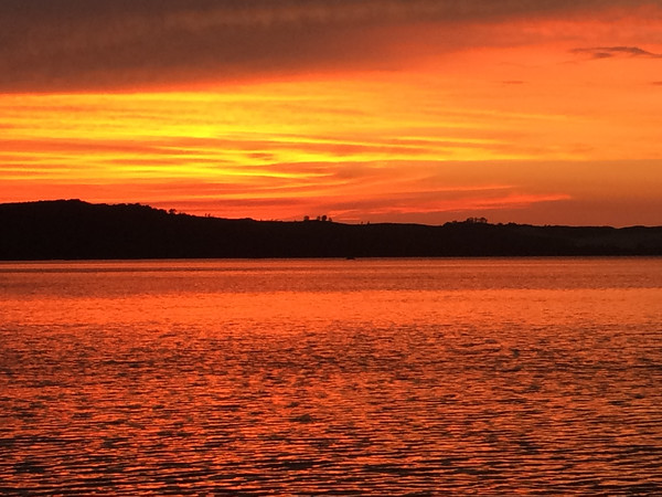 A fiery sunset over Little Glen Lake. Photo by Sharon Geisler.
