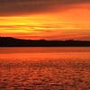 A fiery sunset over Little Glen Lake. Photo by Sharon Geisler.