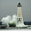 Frankfort Lighthouse with strong southwest winds early in January this year. Photo by Kimberly Kroupa.