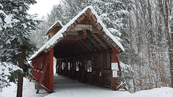 A snow covered bridge just north of Reynolds Road near Lake Ann. Photo by Jeannie Corey.