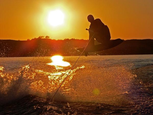 A sunset wakeboard run on Little Glen Lake. Photo by Scott Gravelie.