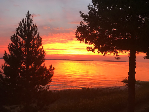 Sunset over Elk Rapids. Photo by Jean Boquist.