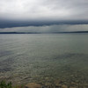 While on bike ride to Charlevoix, a rainstorm came across Torch Lake at us at to force a stop at Clam River. Photo by Russ VanHouzen.