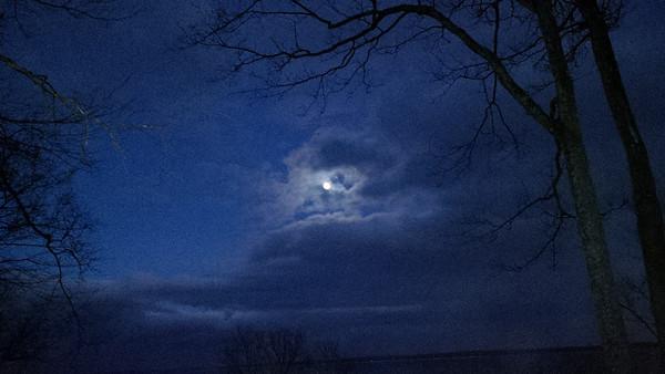 February's full moon over West Bay. Photo by JJ Johnson.