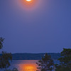 June's Strawberry Moon brightened the short night on the summer solstice over West Bay. Photo by Cathy McKinley.