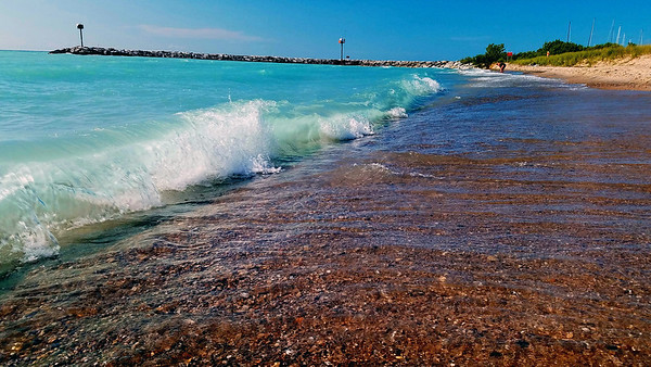 Tropical blue Lake Michigan contrasts against the Leland shore. Photo by Jerry Mikowski.