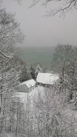 A hint of blue-green is visible on a snowy day over West Bay. Photo by James Johnson.