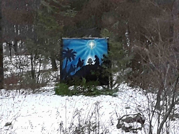 A Christmas scene planted in the woods off Carlson Road. Photo by Don Montie, Northport.
