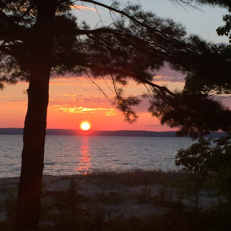 A West Bay sunset from Old Mission Peninsula. Photo by Mary Hartz.