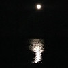 A view of the moon from Old Mission Peninsula looking out on East Bay. Photo by Liz Bevier.