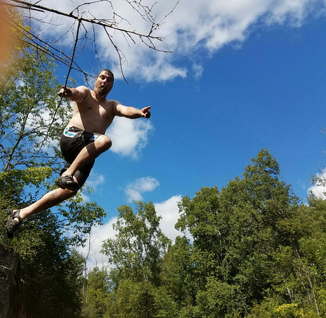 Ed Dunster jumps into the Boardman River swimming hole. Photo by Sheryl Evans.