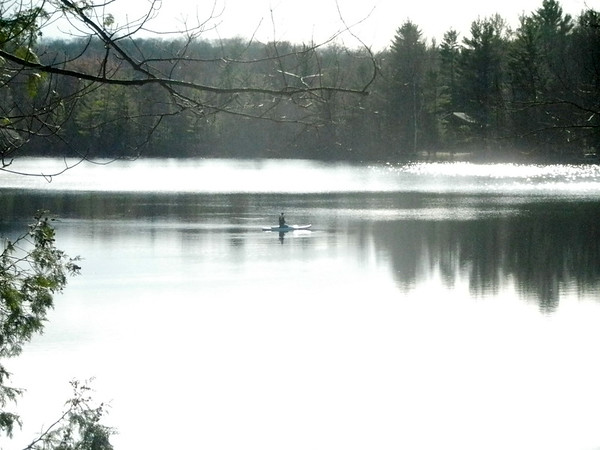 An early fisherman catches the worm on Mickey Lake. Photo by Lynn Huffman.