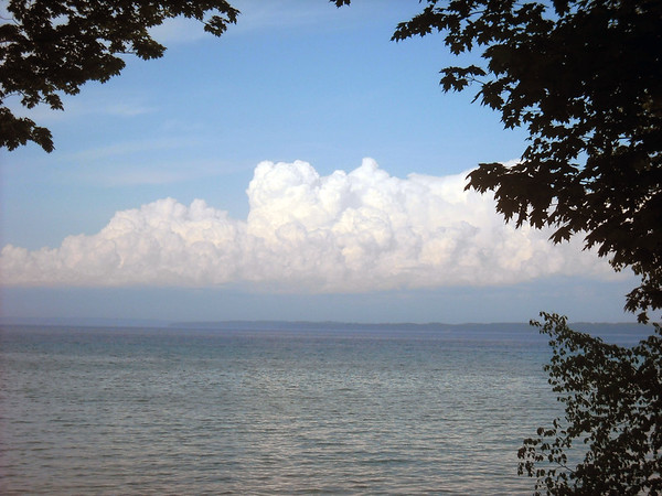 Looking east over Grand Traverse Bay in the evening at a gorgeous cloud bank.  Photo by Mollie Moody.
