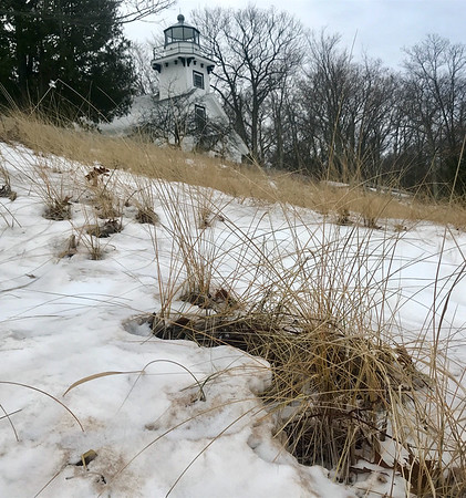 The Mission Point Lighthouse with the latest snowfall. Photo by Ceil Heller.