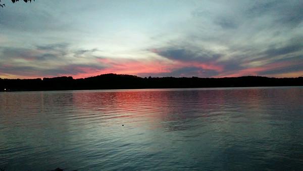 Sunset over S. Lake Leelanau. Photo by Kathie Woods.