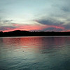 Sunset over S. Lake Leelanau. Photo by Kathie Woods.