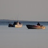 Two boats fishing on West Grand Traverse Bay in the early, early morning. Photo by Jennifer Grochowalski.