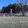 A silo stands amid the ruins of an outbuilding near Northport. Photo by Doug Verellen.