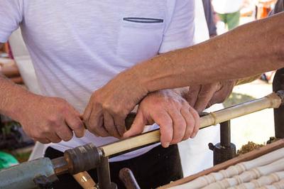 Teaching turning wood. Photo by Gary Keyes.