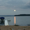 Full moon setting over Bowers Harbor. Photo by Dan Edson.