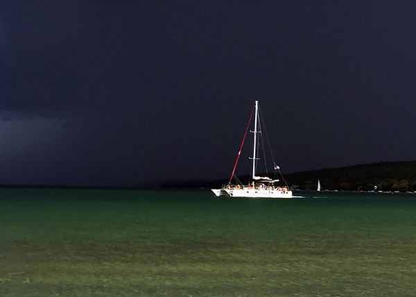 Dark clouds gather before an afternoon storm on West Grand Traverse Bay. Photo by Becky Comstock.