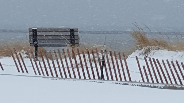 A snowy beach day in Frankfort. Photo by Jeannie Corey.