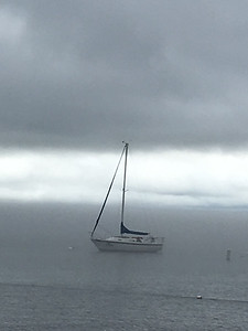 A sailboat moors on West Bay in the calm before the storm. Photo by Meganne McCardel.