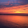 Sunset over Elk Rapids. Photo by Andrea Weyhing.