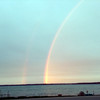 A double rainbow appeared at sunset on May 4. From Old Mission Peninsula, the inner rainbow appears to fall directly over the Grand Traverse Resort. Photo by Joann and Dennis Pearsall.