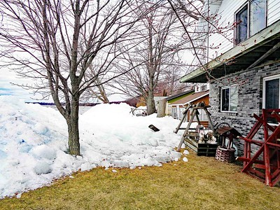 Ice floes pushed ashore Houghton Lake. Photo by Phillip T. Robinson.