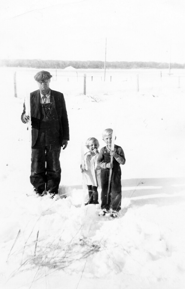 Jacob Schaak, Al, and Arlien holding icicles