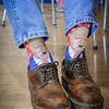 Chairman of Lunenburg Republican Town Committee, Rene M. Lafayette wears some flashy Donald Trump socks at the GOP Caucus. SUN/Caley McGuane