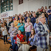 Everyone participates in the Pledge of Allegiance at the GOP Caucus at Gronton Dunstable High. SUN/Caley McGuane