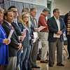 Candidates running for delegate line up at the GOP Caucus. SUN/Caley McGuane