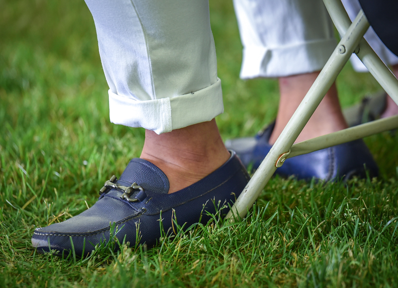 . The fashion was sockless for many of the men Sunday during  graduation ceremonies.  SUN/Scot Langdon