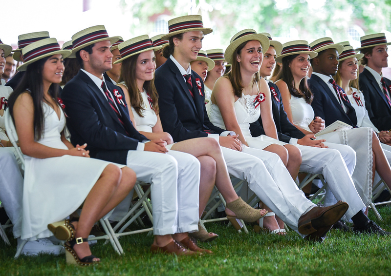 . Students at the Groton School laugh at the humor of their classmate, and Sixth Form Speaker, Christian Lee Carson, during his speech Sunday during graduation ceremonies.  SUN/Scot Langdon