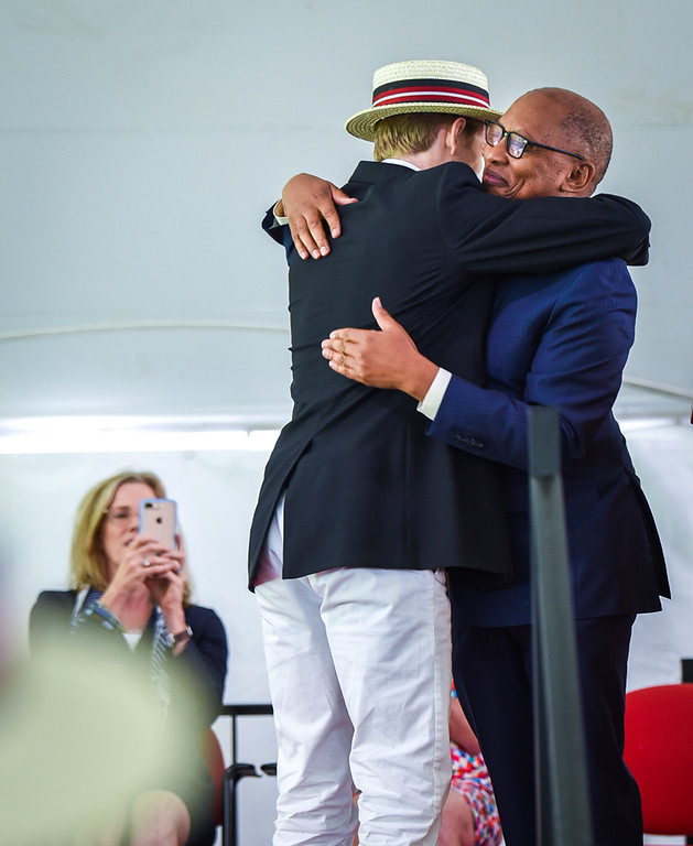 . A Groton School student hugs Temba T. Maqubela, Headmaster at The Groton School Sunday during  graduation ceremonies.  SUN/Scot Langdon