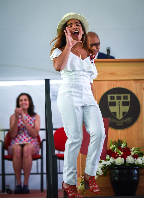 . A Groton School student yells out with joy after receiving her diploma Sunday during  graduation ceremonies.  SUN/Scot Langdon
