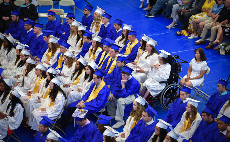 . Senior students listen to speakers during graduation day at Wilmington High School on Sunday.  SUN/Scot Langdon