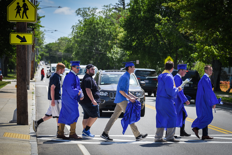 . With traffic backing up 15 car lengths, Wilmington High School graduates make their way across Church St. in Wilmington Sunday.  SUN/Scot Langdon