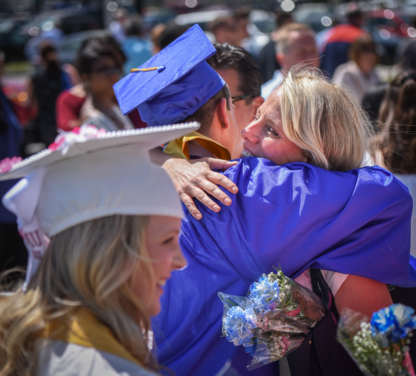 . Students celebrate graduation day with family at Wilmington High School on Sunday.  SUN/Scot Langdon