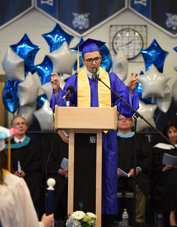 . Senior student speaks to the class during graduation ceremonies at Wilmington High School on Sunday.  SUN/Scot Langdon