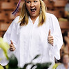 TIM JEAN/Staff photo. Madison Hicks flashes the two-thumbs up sign as she makes her way to pick up her diploma during Londonderry High School graduation ceremony at the Verizon Wireless Arena in Manchester.  6/12/15