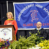 TIM JEAN/Staff photo. Eva Koch, Faculty Speaker addresses the class of 2015 during Londonderry High School graduation ceremony at the Verizon Wireless Arena in Manchester.  6/12/15