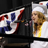 TIM JEAN/Staff photo. Madeleine Doris sings and plays the piano during Londonderry High School graduation ceremony at the Verizon Wireless Arena in Manchester.  6/12/15